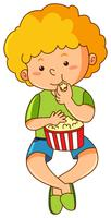 Little boy eating popcorn