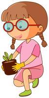 Menina, segurando, panela planta