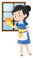 Gelukkig dienstmeisje schoonmaak venster