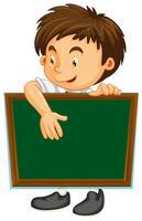 Happy boy with green board