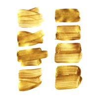 Conjunto de mancha de pincel de pintura de ouro isolado no fundo branco