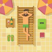 Homme se détendre sur une chaise longue au bord de la piscine
