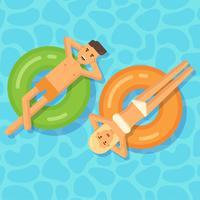 Hombre y mujer flotando en círculos inflables en una piscina