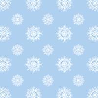 Blå snöflingor mönster. Vita snöflingor mönster på blå bakgrund