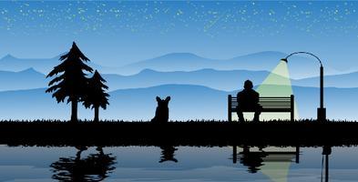 Hombre sentado solo en el paisaje