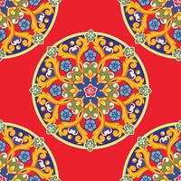 Seamless pattern background. Colorful ethnic round ornamental mandala on red. Vector illustration