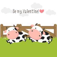 Paare von netten verliebten Kühen auf grüner Rasenfläche.