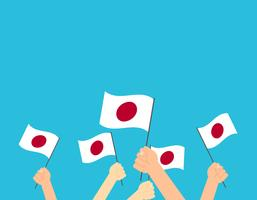 Vector illustration hands holding Japan flags on blue background