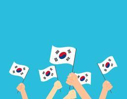 Manos de ilustración vectorial sosteniendo banderas de Corea del sur - tarjeta de felicitación del día de la independencia de Corea del sur
