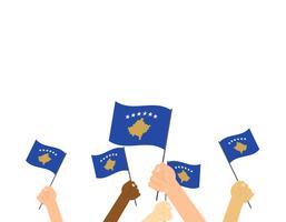 Vectorillustratieg handen die de vlaggen van Kosovo houden die op witte achtergrond worden geïsoleerd