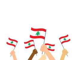 Vector illustration hands holding Lebanon flags on white background