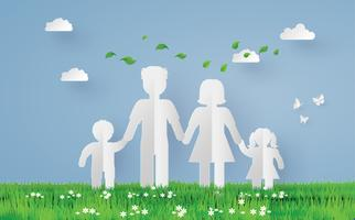 papierfamilie op het grasgebied