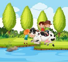 Children riding animal in nature