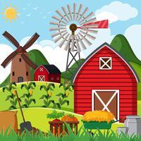 Escena de la granja con granero rojo