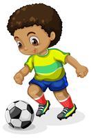 Chico corriendo con la pelota de futbol