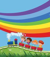 Zug mit Kindern vor Regenbogen