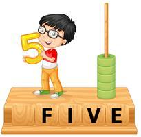 En pojke som håller nummer fem