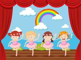 Vier meisjes dansen op het podium