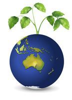 Een plant boven de planeet aarde