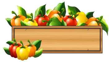 Bell peppers and wooden board vector