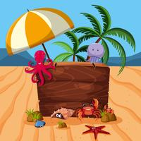 Wooden sign with many sea animals on beach vector