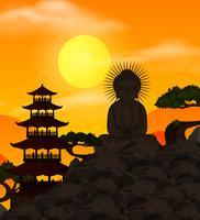 Kinesisk mall med Buddha figur vid solnedgången