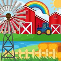 Farm scene with rainbow in sky