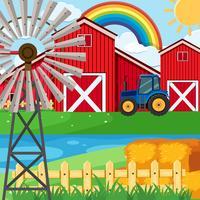 Farm scene with rainbow in sky
