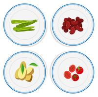 Different vegetables on round plates