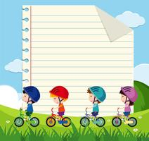 Paper template with kids cycling in the park