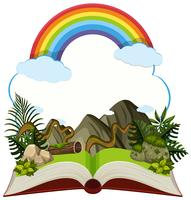 Storybook with mountain and rainbow vector