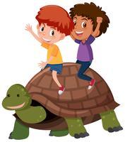 Bambini in sella a una tartaruga