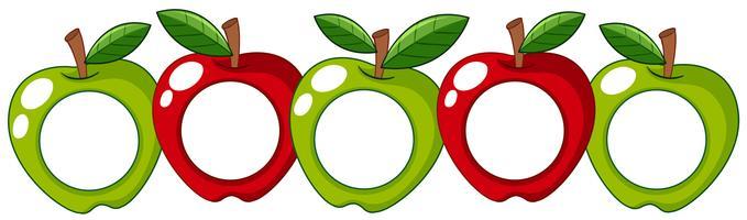 Röda och gröna äpplen med vit märke på