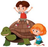 Niños montando una tortuga
