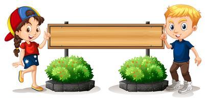 Ragazzo e ragazza dalla tavola di legno