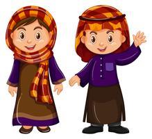 Jongen en meisje in Irag-kostuum