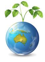 Planeta Terra com uma planta verde crescente