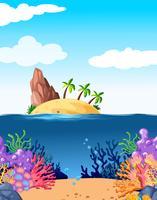 Scène met eiland en koraal onderwater