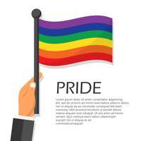 Illustrazione vettoriale per la celebrazione dell'evento mese orgoglio. Mano che tiene la bandiera arcobaleno.