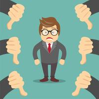 Sad businessman and many hands with thumbs down
