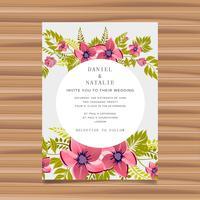 De kaartuitnodiging van het huwelijk met bloemdecoratie