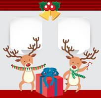 Christmas card with two reindeers and present