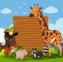 Wooden board template with wild animals in garden