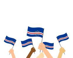 Vector l'illustrazione delle mani che tengono le bandiere di Capo Verde isolate su fondo bianco