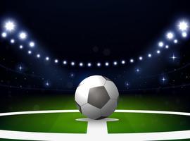 Fotbollsstadion med boll och strålkastare på natten