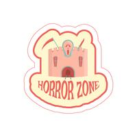 Sticker with cartoon horror castle and text.