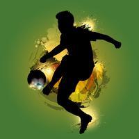 Fußballspieler, der Tintenspritzen tritt