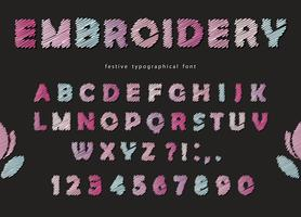 Embroidery font design. Cute ABC letters and numbers in pastel colors on the black background.