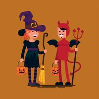 halloween kids wearing Devil and Witch costumes