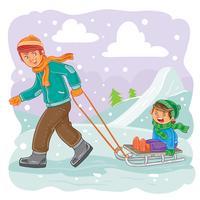 Vater rollt seinen Sohn auf einem Schlitten im Schnee